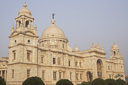 kolkata: Victoria Memorial in Kolkata India. Ornate white marble building. Constructed as a monument to Queen Victoria of Great Britain now a museum. Stock Photo