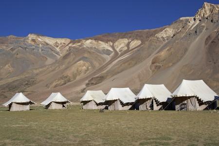 leh: Tented tourist camp on the high altitude Lingani plains at Sarchu (4200m) on the Manali to Leh mountain road. Ladakh India