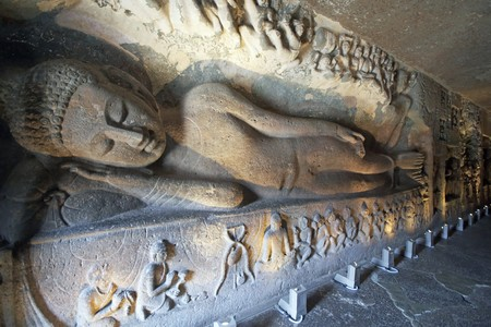Statue of a reclining Buddha carved on the wall of the ancient Buddhist rock temple (Mahayan Chaitya-Griha Cave Temple) Ajanta Caves near Aurangabad India. 5th-6th Century AD. Stock Photo