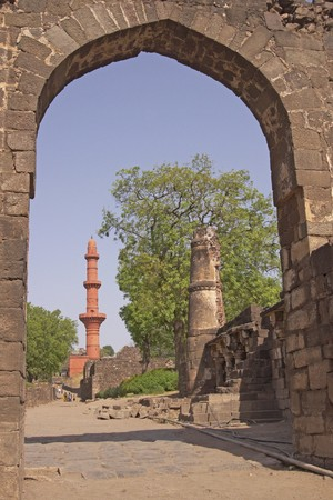 ad: Islamic victory tower (Chand Minar) framed in the entrance to Daulatabad Fort India. 14th Century AD