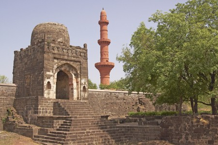 chand: Entrance to the Mosque inside Daulatabad Fortress India. Islamic victory tower (Chand Minar) in the background. 14th Century AD