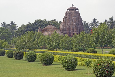 Ancient Hindu Temple (Rajarani Temple). Ornately carved building with large tower set in landscaped gardens. Bhubaneswar, Orissa, India. 11th Century AD