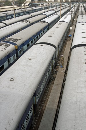 Trains waiting in sidings at Old Delhi station, India.