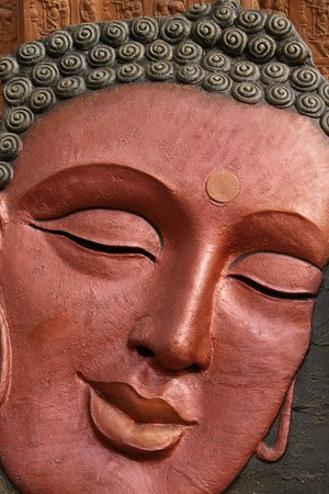 sarujkund: Face of Buddha for sale at an Indian crafts fair.