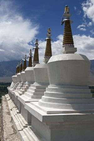 leh: Row of stupas topped with gold crowns at Shey Buddhist monastery. Leh, Ladakh, India