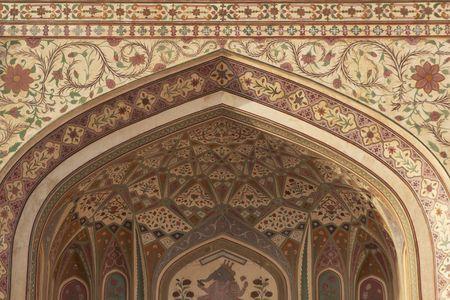 Detail of ornately decorated gateway (Ganesh Pol) inside Amber Palace Jaipur Rajasthan India