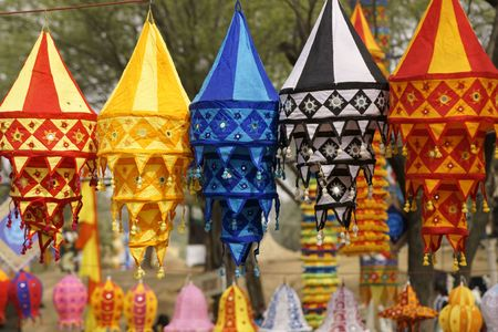 sarujkund: Colorful array of Tibetan Lanterns hanging on a string at an Indian Market. Sarujkund, Haryana, India Stock Photo