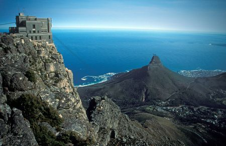 Cable car station on top of table Mountain, Cape Town, South Africa. Lions Head mountain and the blue expanse of the sea beyond.