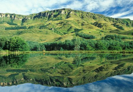 symmetry: Drakensberg mountains reflected in a lake. KwaZulu Natal, South Africa Stock Photo