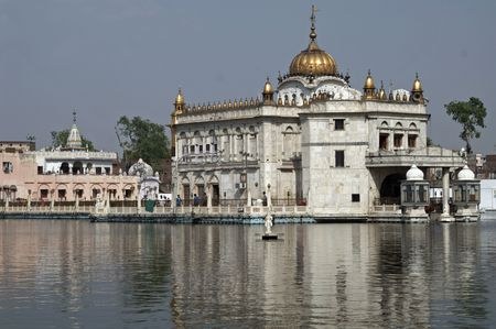 dome of hindu temple: Hindu Temple in the middle of a lake. Amritsar India