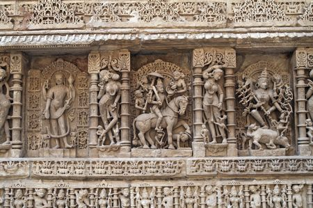 11th century: Ornate stone carved walls lining the 11th century step well at Patan, Gujarat, India Stock Photo
