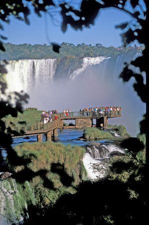 Viewing platform full of people at Iguacu Falls, Brazil.