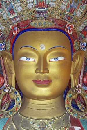 Head of a golden Buddha inside a temple at Thikse monastery. Ladakh, India photo