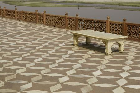 Marble bench on a tiled terrace overlooking the River Yamuna at the Taj Mahal, Agra, India photo