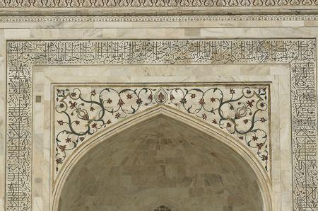 pradesh: Detail of white mable arch inlaid with semi-precious stones. Taj Mahal, Agra, Uttar Pradesh, India