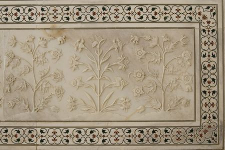 Detail of flowers carved in white mable decorating the Taj Mahal in Agra, Uttar Pradesh, India photo