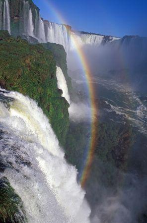Rainbow formed by the spray of Iguacu Falls, Brazil. Stock Photo