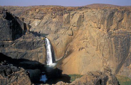southern africa: Waterfall on the Orange River running through the rugged landscape of Augrabies National Park, South Africa