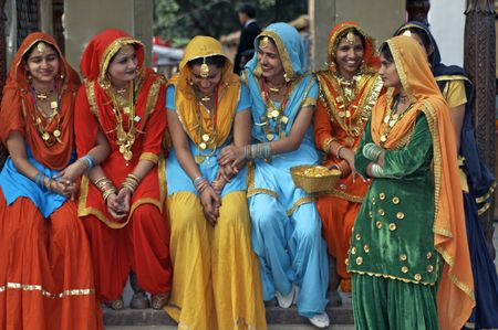 india people: Haryana, India - February 15, 2007: Group of colorfully dressed Indian ladies at the Surajkund Festival in Haryana near Delhi, India.