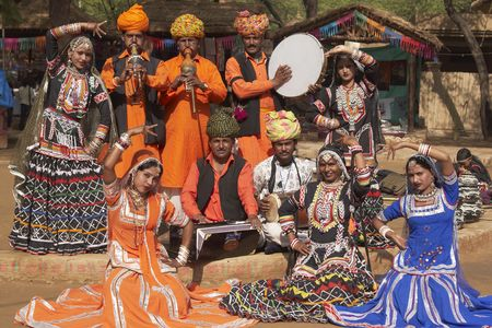 sarujkund: Haryana, India - February 13, 2009: Group of tribal dancers and musicians at the Sarujkund Fair near Delhi, India  Editorial