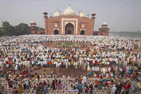 Agra, Uttar Pradesh, India - October 2, 2008: Thousands of people gather in front of the mosque at the Taj Mahal to celebrate the Muslim festival of Eid ul-Fitr in Agra, Uttar Pradesh, India