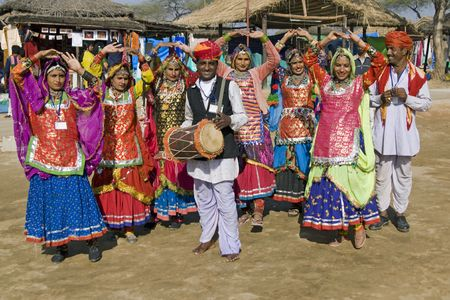 sarujkund: Haryana, India - February 11, 2008: Traditional Indian tribal dance group at the Sarujkund Fair in Haryana, India