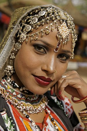 haryana: Haryana, India - February 12, 2009: Portrait of a beautiful Indian Kalbelia dancer in ornate headdress and traditional jewellery at the Sarujkund Craft Fair in Haryana near Delhi, India.