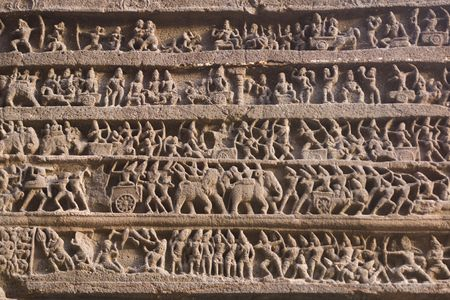 Hindu religious story carved into the rock face at the ancient Hindu Temple (Kailas Temple). Ellora Caves,  India. 8th Century AD