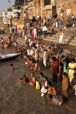 ganges: Varanasi, India - October 10, 2007: Crowds of people worshiping bathing in the sacred River Ganges at Varanasi, India