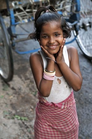 Delhi, India - May 25, 2006: Indian street girl smiling in Old Delhi, India