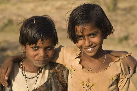 Orchha, India - March 27, 2007: Happy smiling sisters from a poor Indian family in Orchha, Madhya Pradesh, India