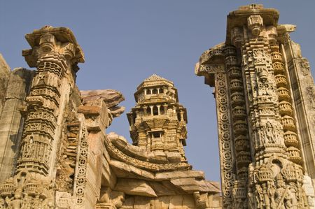 impregnable: Ornate carved stone victory tower (Vijay Stambha) built to celebrate an ancient victory. Chittaugarh, Rajasthan, India. Stock Photo
