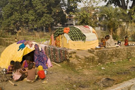 bihar: Bihar, India - November 27, 2007: Home is a makeshift shack for these poor families in Sonepur, Bihar, India. Editorial