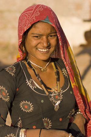 india cow: Nagaur, India - February 16, 2008: Indian woman at the Nagaur Cattle Fair in Rajasthan, India Editorial