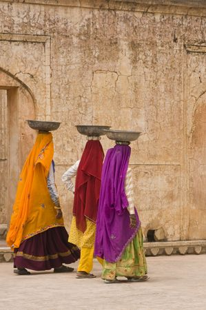 poverty in india: ndian women laborers at work restoring an old palace, Jaipur, Rajasthan, India