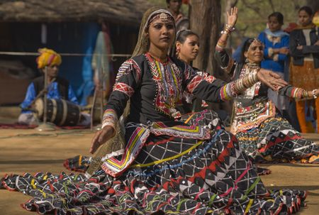haryana: Haryana, India - February 11, 2008: Indian kalbelia dancer performing in a traditional tribal costume at the annual Sarujkund Fair near Delhi, India Editorial