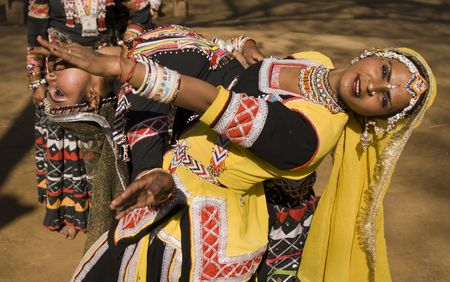 haryana: Haryana, India - February 11, 2008: Indian kalbelia dancers in action in traditional yellow and black clothing Editorial