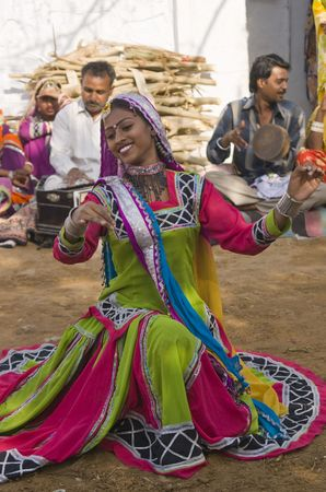 Jaipur, India - March 9, 2009: Beautiful tribal dancer in colorful costume performing in Jaipur, Rajasthan, India