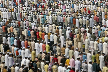 eid: Agra, India - October 2, 2009: Thousands of people gather in front of the mosque at the Taj Mahal to celebrate the Muslim festival of Eid ul-Fitr in Agra, Uttar Pradesh, India
