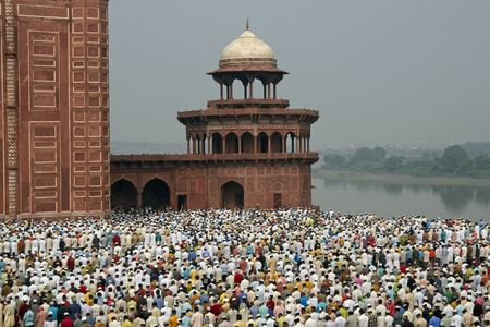 Agra, India - October 2, 2009: Thousands of people gather in front of the mosque at the Taj Mahal to celebrate the Muslim festival of Eid ul-Fitr in Agra, Uttar Pradesh, India