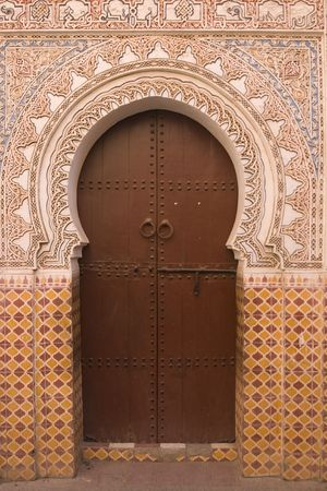 key hole shape: Entrance to a traditional riad in the shape of a key hole in Marrakesh, Morocco
