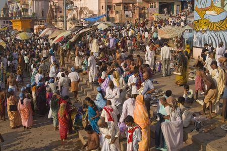 benares: Varanasi, Uttar Pradesh, India - October 11, 2007: Crowds of people bathing in the sacred River Ganges in the sacred city of Varanasi, Uttar Pradesh, India
