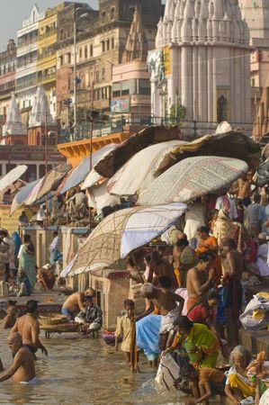 uttar: Varanasi, Uttar Pradesh, India - October 11, 2007: Crowds of people bathing in the sacred River Ganges in the sacred city of Varanasi, Uttar Pradesh, India