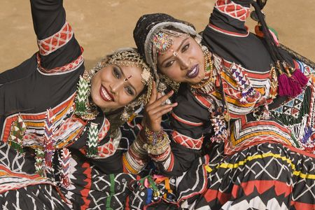kalbelia: Beautiful Kalbelia dancers in ornate black costumes trimmed with beads and sequins at the annual Sarujkund Fair near Delhi, India. Stock Photo