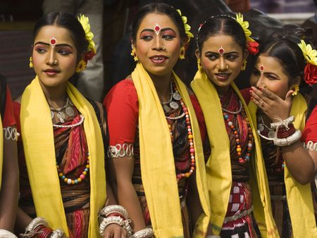 Haryana, India - February 12, 2009: Group of teenage Indian dancers in traditional tribal outfit at the Sarujkund Craft Fair in Haryana near Delhi, India.