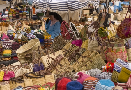 souk: Marrakesh, Morocco - August 19, 2009: Woman selling baskets of all shapes and sizes in the main souk of Marrakesh, Morocco. Editorial