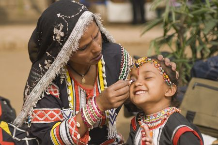 Young Rajasthani dancer gets ready to perform at the Sarujkund Fair near Delhi in India. photo