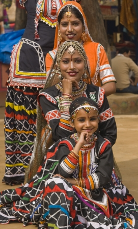 india people: Group of Kalbelia tribal dancers performing at the annual Sarujkund Fair near Delhi, India