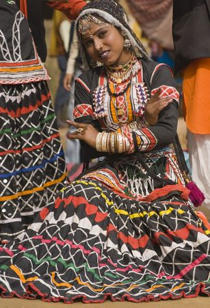 sarujkund: Beautiful Kalbelia dancer from the Jaipur area of Rajasthan, India. Dressed in ornate black costume trimmed with beads and sequins.