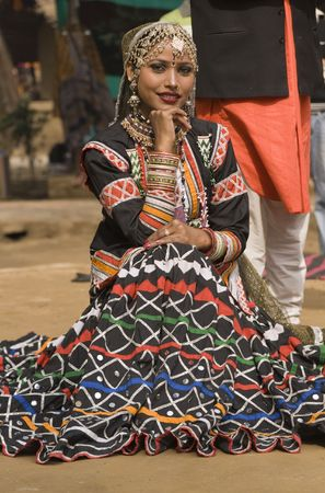 Beautiful Kalbelia dancer from the Jaipur area of Rajasthan, India. Dressed in ornate black costume trimmed with beads and sequins. Stock Photo - 7878304